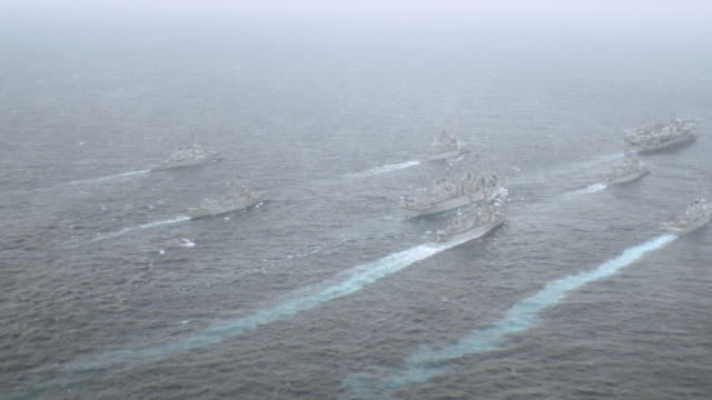 an aircraft carrier leads a naval task force. - flotilla stock videos & royalty-free footage