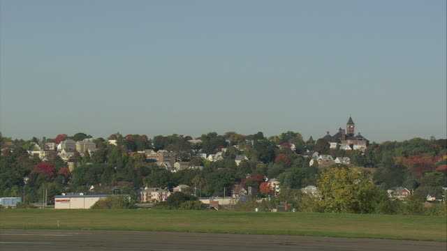 arieal an aircraft lifting off from runway and views of lowell / lowell, massachusetts, united states - lowell stock videos & royalty-free footage