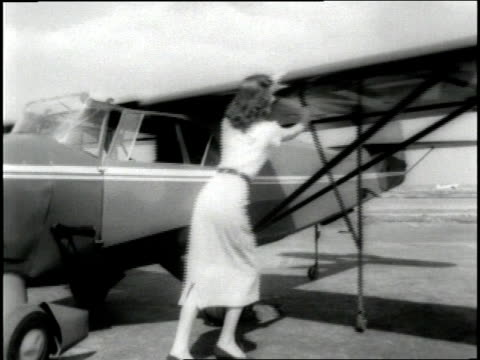 an airphibian airplane converts into a car and drives down a city street. - anno 1952 video stock e b–roll