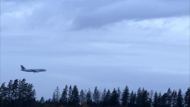 An airplane arrives Sweden.