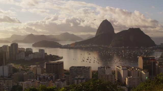 An airplane flies over Botafogo Bay - Rio de Janeiro, Brazil.