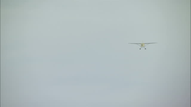 an airplane flies through foggy skies. - whitehorse stock videos and b-roll footage