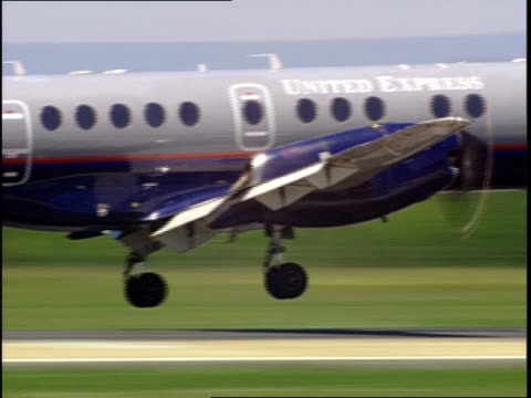 an airplane lands at dulles international airport. - dulles international airport stock videos and b-roll footage