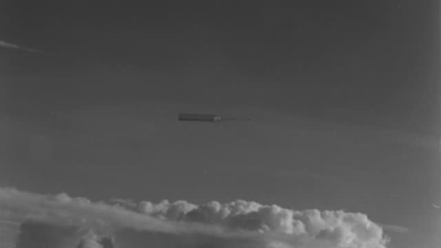 an airplane pulls a military target through a cloudy sky. - 1943 stock videos & royalty-free footage