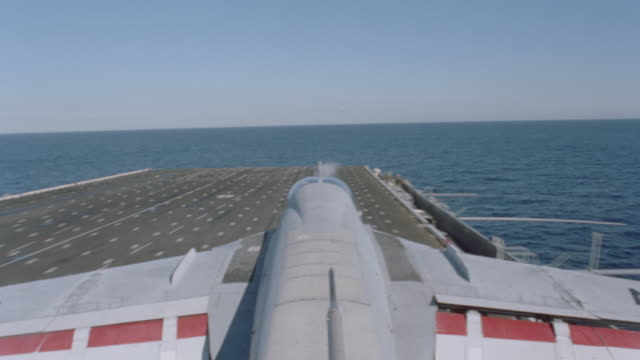 an airplane takes off from an aircraft carrier. - aircraft carrier stock videos & royalty-free footage