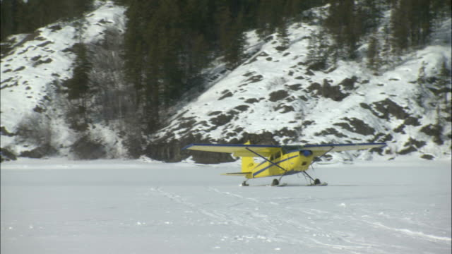 an airplane takes off  from frozen tagish lake in the yukon territory. - whitehorse stock videos and b-roll footage