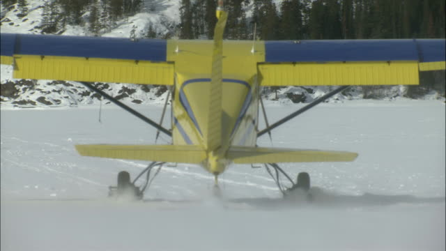an airplane taxis on a frozen tagish lake. - whitehorse stock videos and b-roll footage