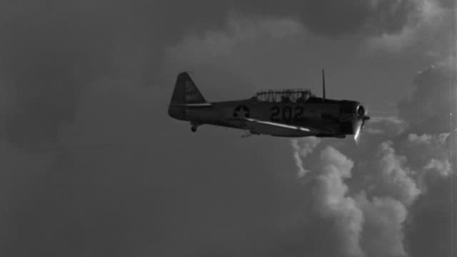 an airplane tows a rope in a cloudy sky. - 1943 stock videos & royalty-free footage