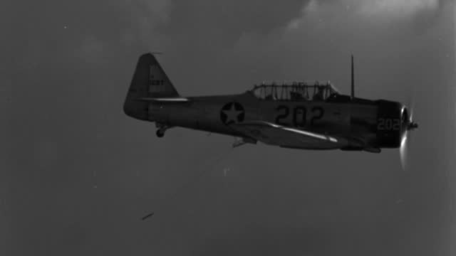 an airplane tows a rope in the sky. - 1943 stock videos & royalty-free footage