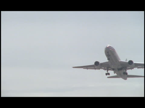 an airplane's landing gear retracts as the plane ascends. - kennedy airport stock videos & royalty-free footage