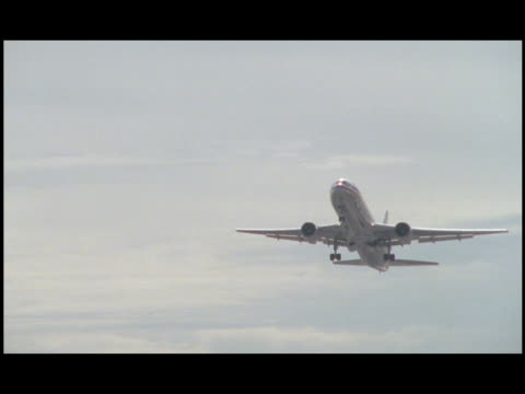 an airplane's landing gear retracts as the plane takes off from jfk airport. - john f kennedy airport stock videos & royalty-free footage