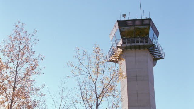 an airport control tower overlooks an exxon fuel truck. - exxon stock videos & royalty-free footage