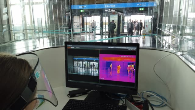 an airport employee checks thermal imaging screen at a security check-point at istanbul airport on june 01, 2020 in istanbul, turkey. as infection... - thermal imaging stock videos & royalty-free footage