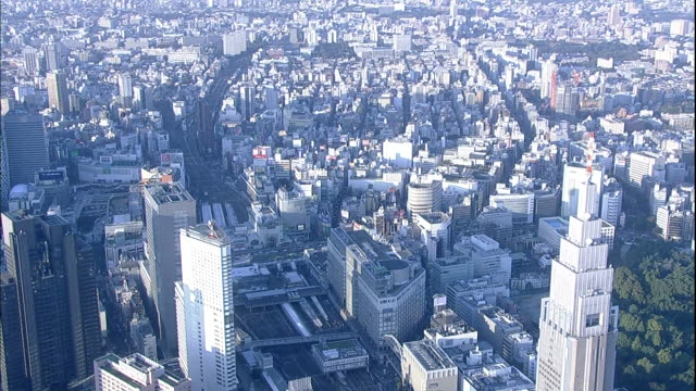 An airship sails over skyscrapers near the Shinjuku Station in Tokyo, Japan.