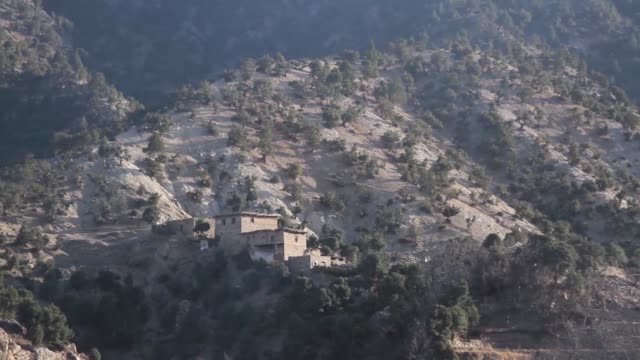 vídeos de stock e filmes b-roll de an airstrike destroys an isisk fighting position during afghan commando offensive operations in mohmand valley nangarhar province over the winter... - ataque aéreo