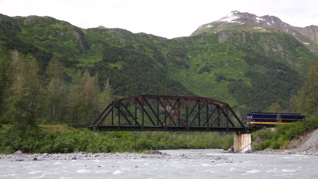 an alaska railroad train crosses a railway bridge at spencer glacier in chugach national forest. - chugach national forest stock videos & royalty-free footage