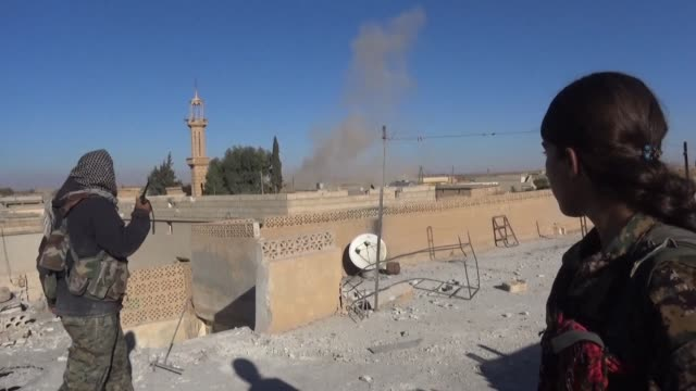 an alliance of kurdish and arab fighters known as the syrian democratic forces say they have seized the hilltop village of tal saman from the islamic... - syrian democratic forces stock videos & royalty-free footage