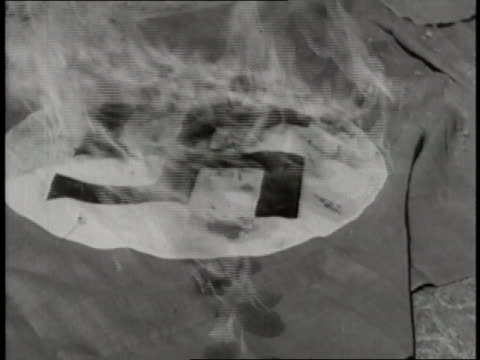 vídeos de stock, filmes e b-roll de an allied soldier sets a nazi flag on fire as allied troops liberate belgium during world war ii. - forças aliadas