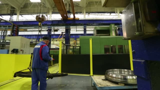 an alstom logo sits on a sign as it hangs outside the reception at alstom sas power plant turbine refurbishment facility in rugby, uk, an alstom... - workbench stock videos & royalty-free footage