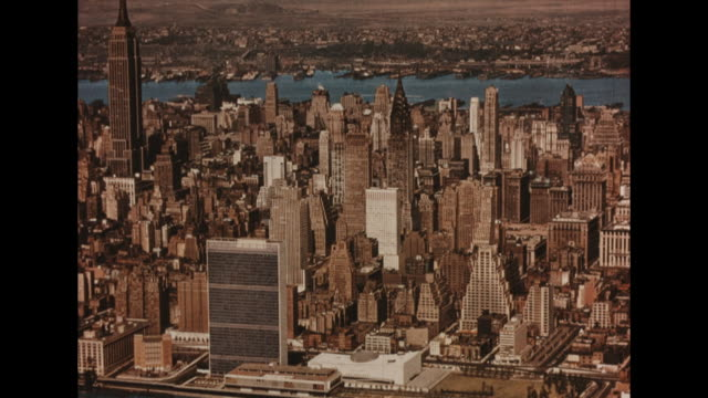 """an amateur home movie title card precede two still aerial images of manhattan taken from the eastside. the title card reads: """"ny city top rca... - rca stock videos & royalty-free footage"""