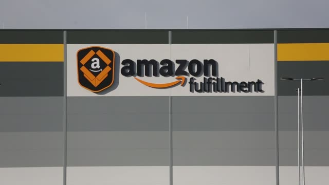 an amazon fulfillment logo sits on display outside the new amazoncom inc fulfillment center on its opening day in dobroviz czech republic on tuesday... - logo stock-videos und b-roll-filmmaterial