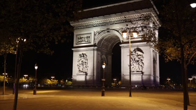 an ambulance crosses the place de l'etoile at curfew time on october 18, 2020 in paris, france. france. the french government has imposed a night... - triumphal arch stock videos & royalty-free footage