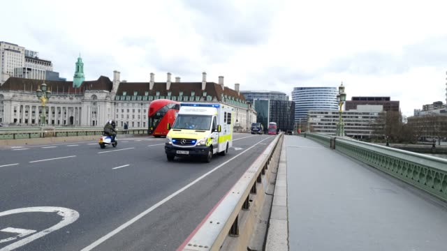 an ambulance crosses westminster bridge with the closed london eye in the background during the coronavirus pandemic on march 20 2020 in london... - ambulance stock videos & royalty-free footage