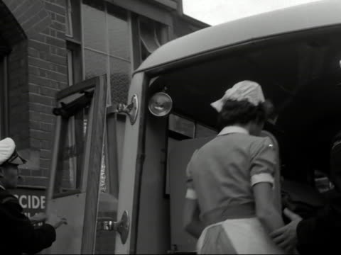 an ambulance delivers a patient to a hospital - bbc archive stock-videos und b-roll-filmmaterial