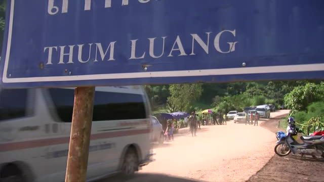 an ambulance drives away at thum luang cave in mae sai, thailand. - thailand stock videos & royalty-free footage