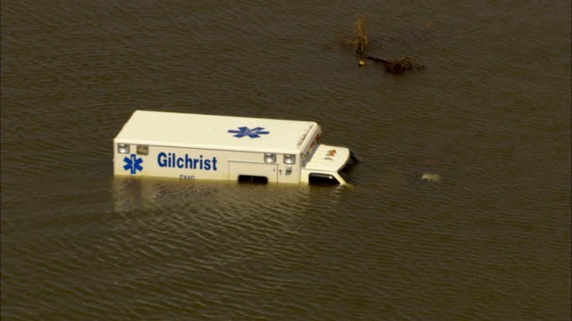 an ambulance is submerged in water after a hurricane. - vortex stock videos & royalty-free footage