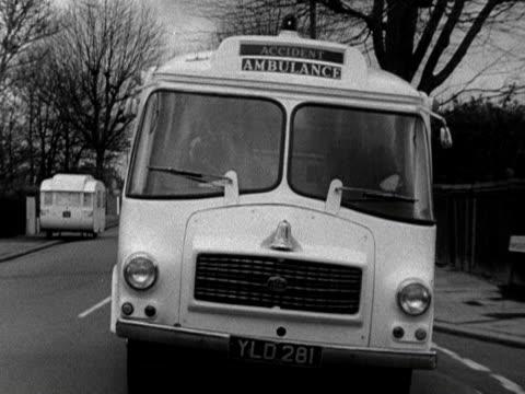An ambulance moves along a road 1968