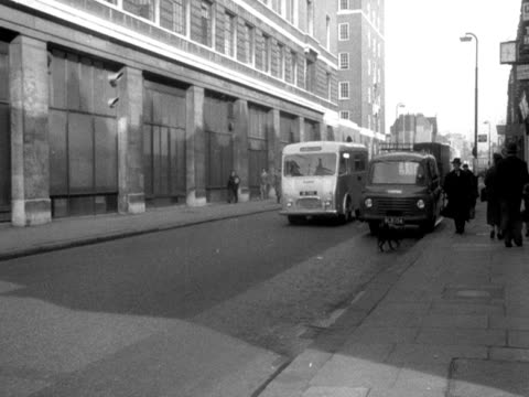 An ambulance moves along Praed Street and then drives under an archway to St Mary's Hospital 1950's
