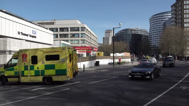 an ambulance pulls into the accident and emergency entrance at st thomas' hospital, where uk prime minister boris johnson remains in a stable... - boris johnson stock videos & royalty-free footage