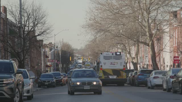 an ambulance speeds down the street on february 26, 2021 in baltimore, maryland. the state's seven-day testing positivity rate was at 3.66% on friday. - maryland us state stock videos & royalty-free footage