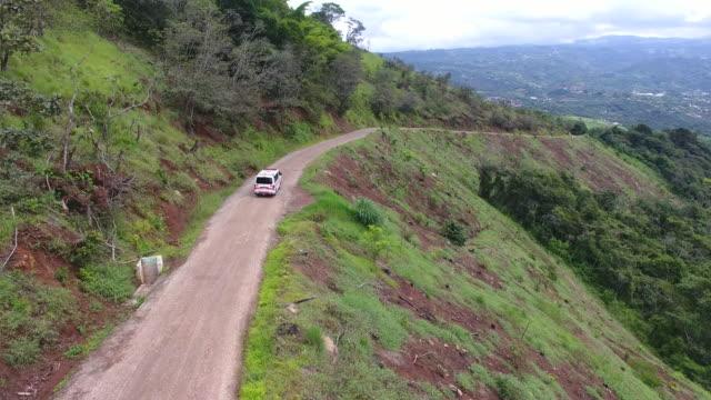 an ambulance travels along a dirt road - 未舗装点の映像素材/bロール