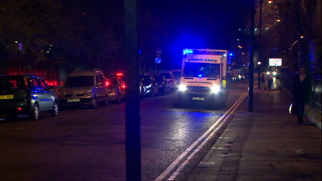 an ambulance with flashing blue lights and sirens on turns right into the royal victoria infirmary in newcastle amid concern that the nhs cannot cope... - siren stock videos & royalty-free footage