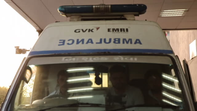 an ambulance with sirens blaring approaches a hospital in gujarat india in the midst of an outbreak of swine flu - front view stock videos & royalty-free footage