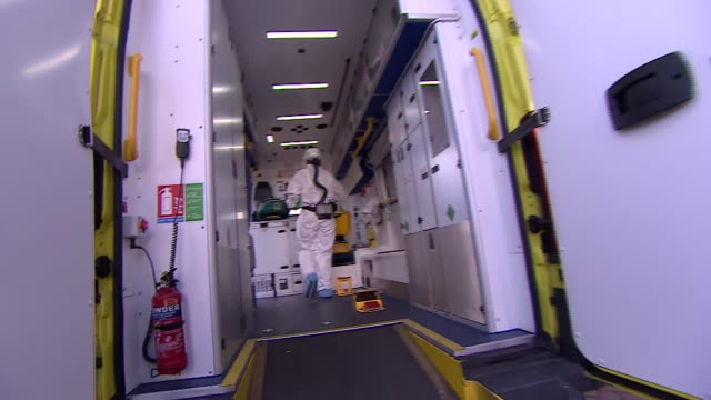 an ambulance worker in protective clothing to protect from coronavirus - ambulance stock videos & royalty-free footage