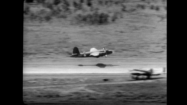 an american b-26 bomber landing without landing gear on a dirt airstrip / emergency landing. wwii in new guinea on january 01, 1940 in papua new... - landefahrwerk stock-videos und b-roll-filmmaterial
