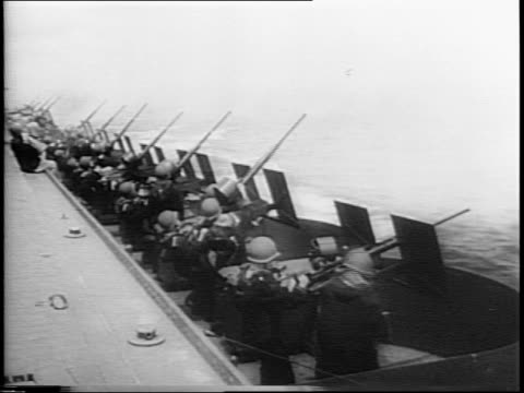 an american convoy crosses the pacific in smooth seas / japanese plane appears overhead and attacks convoy / american battleships return antiaircraft... - flugabwehr stock-videos und b-roll-filmmaterial