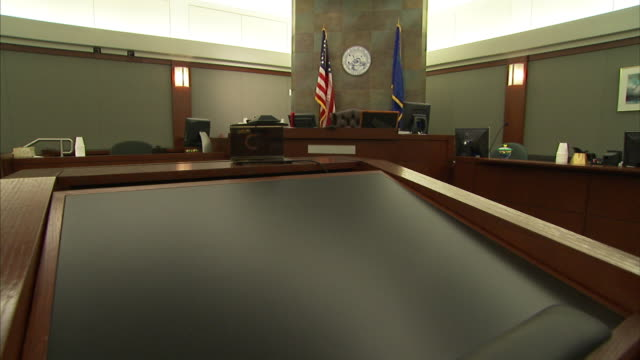an american flag and the city of las vegas flag decorate a courtroom. - courthouse stock videos & royalty-free footage