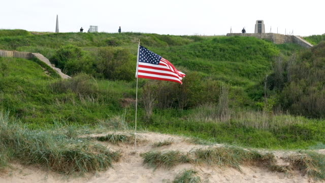 an american flag flied planted at omaha beach in normandy on june 02 2019 near collevillesurmer france june 6 will mark the 75th anniversary of the... - omaha beach stock videos and b-roll footage