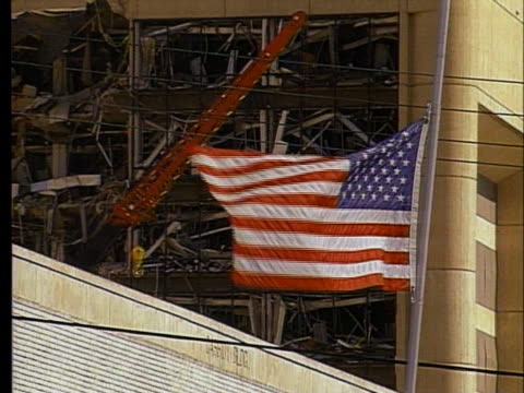an american flag flies at half mast near the site of the bombing of the a.p. murrah federal building in oklahoma city. - oklahoma city bombing stock videos & royalty-free footage