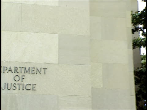 an american flag flies in front of the department of justice. - department of justice stock videos & royalty-free footage