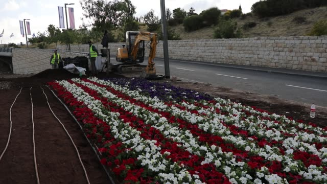 an american flag is designed out of flowers at the entrance to the new american embassy in jerusalem which is scheduled to open next week on may 9... - embassy stock videos and b-roll footage