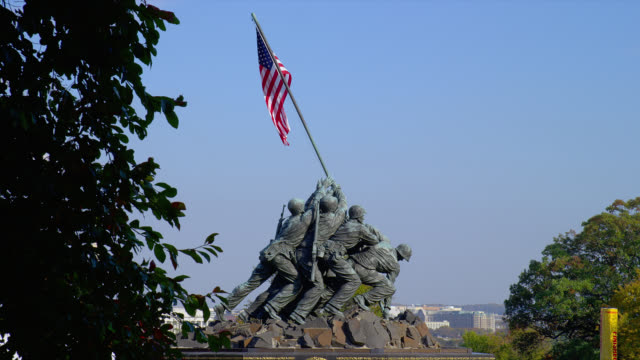 An American flag waves from the Iwo Jima Memorial in Arlington, Virginia.