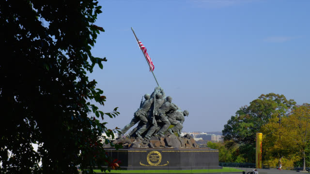An American flag waves from the Iwo Jima Memorial.