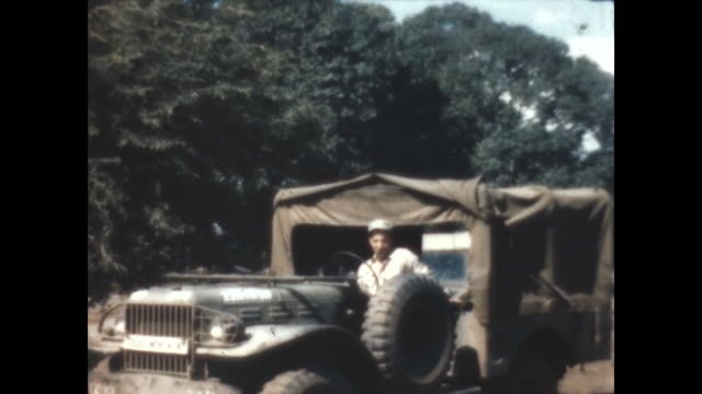 an american gi drives a ford jeep at clark airfield. - 1946 stock videos & royalty-free footage