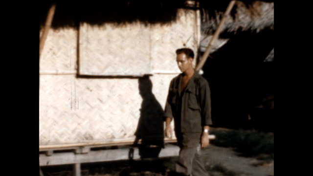an american gi returns to his thatched hut at clark air base during wwii. - 1946 stock videos & royalty-free footage