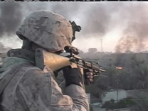 an american soldier aims his rifle at a distant fire in iraq. - (war or terrorism or election or government or illness or news event or speech or politics or politician or conflict or military or extreme weather or business or economy) and not usa stock videos & royalty-free footage